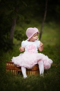 cute little girl with suitcase and dandelion